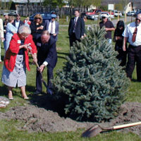 Tree Planting For LCpl Judge and Cpl McMahon: Mr. and Mrs. Judge plant their sons tree.